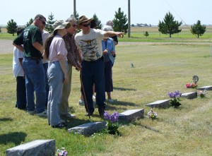 My parents talking to my grandpa at the cemetery in Tyrone, Oklahoma